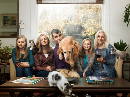Family picture chaos with cats, a dog, and 3 teenage girls.