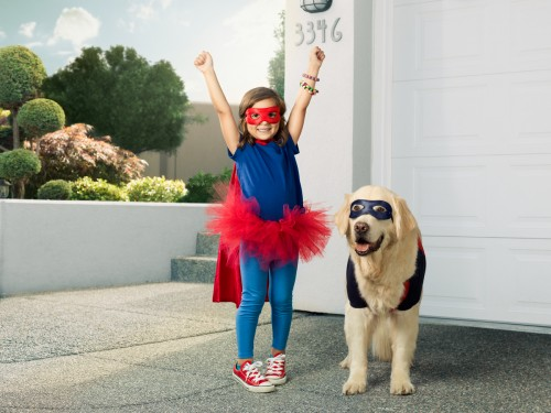 Little girl super hero and her super hero dog.